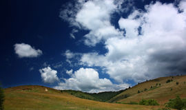 Green hills and blue sky. Green hills and beautiful summer sky with clouds Royalty Free Stock Photos