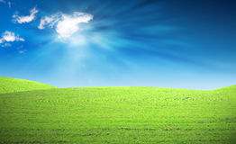 Green hills and blue sky Stock Images