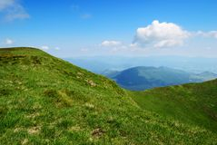 Green hills and blue sky with clouds Stock Image