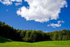 Green hills and blue sky with clouds Stock Photos