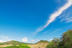 Green hills and blue sky with clouds on a sunny day Royalty Free Stock Photo