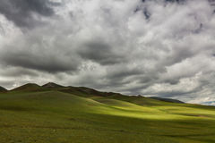Green hills with clouds. Mongolian hills Stock Images