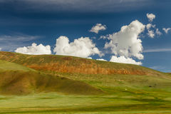 Green hills with clouds. Mongolian hills Royalty Free Stock Photo