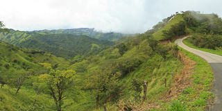 Green Hills of Costa Rica. The verdant hills of Gunanacaste, Costa Rica on a foggy, rainy day (panorama Royalty Free Stock Photography