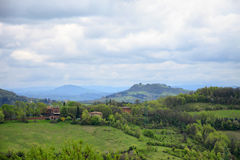 Green hills with country houses nearby Bologna Royalty Free Stock Images