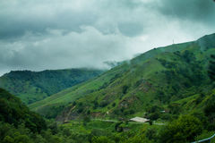 Green Hills, Forest and Cloudy Sky Royalty Free Stock Image