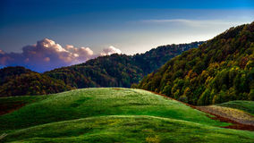 Green hills. Highlands theme with green hills and fluffy clouds Royalty Free Stock Photo