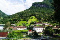 Green hills with houses in Italy. Beautiful view of the houses on a green hill. Landscape with green hills stock image