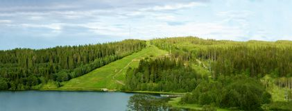 Green hills with a lake Royalty Free Stock Image