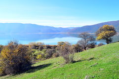 Green hills and a lakescape. Beautiful green hills and the small Prespa lake in Greece Stock Photography