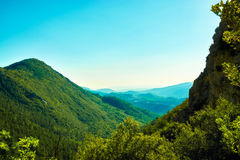 Green hills and landscape in southern France. Artistic image of mountains and nature during summer time Stock Photo