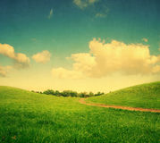 Green hills and lane, vintage colors Stock Photos