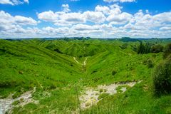 On the road, forgotten world highway, new zealand 13. Green hills, lush grass, blue sky with white clouds. on the road, forgotten world highway, new zealand stock photography