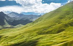 Picturesque Mountain Landscape. Green Hill And Mountain Range On A Sunny Summer Day. Elbrus Region, North Caucasus, Russia Royalty Free Stock Photography
