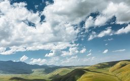 Green Hills And Mountain Range On A Sunny Summer Day. Elbrus Region, North Caucasus, Russia Stock Photography