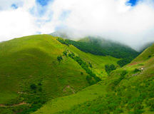 Green hills. Mountains and clouds Stock Photo