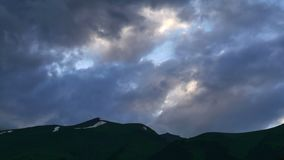 Green Hills and Mountains with sunset storm clouds Timelapse. Kavkaz region.  stock video footage