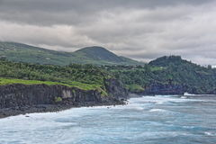 Green hills near the Indian Ocean. In the Reunion island stock photography