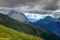 Green hills, rocky ridges and Monte Peralba Carnic Alps Italy. Green hills and rocky ridges of Carnic Alps with towering giant limestone Monte Peralba Royalty Free Stock Images
