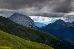 Green hills, rocky ridges and Monte Peralba peak in Carnic Alps Royalty Free Stock Photography
