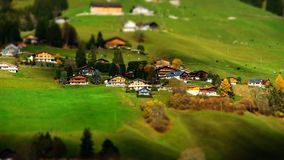 Green hills in swiss valley tilt shift view, sunny day. Chateau-dOex, Switzerland stock photos