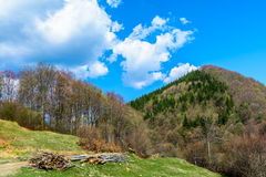 Green hills traditional landscape over cloudy sky on background. Hikers paradise in the countryside Romania. Stock Photo