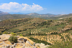 Green hills and valleys around the ruins of Mycenae royalty free stock photo