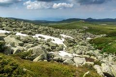 Green hills of Vitosha Mountain near Cherni Vrah Peak, Sofia City Region, Bulgaria. Beautiful green hills of Vitosha Mountain near Cherni Vrah Peak, Sofia City royalty free stock images