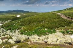 Green hills of Vitosha Mountain near Cherni Vrah Peak, Sofia City Region, Bulgaria. Beautiful green hills of Vitosha Mountain near Cherni Vrah Peak, Sofia City stock photos