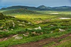 Green hills of Vitosha Mountain near Cherni Vrah Peak, Sofia City Region, Bulgaria. Beautiful green hills of Vitosha Mountain near Cherni Vrah Peak, Sofia City stock images