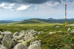 Green hills of Vitosha Mountain near Cherni Vrah Peak, Sofia City Region, Bulgaria. Beautiful green hills of Vitosha Mountain near Cherni Vrah Peak, Sofia City royalty free stock photo