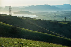 Green hills and wires in Crimea Stock Photography
