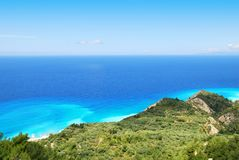 Green hillside and vast blue sea on the island of Lefkada Stock Photos