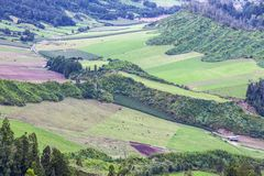 Green hilly terrain on Sao Miguel island of Azores, Portugal. Typical hilly terrain near the Lake of Sete Cidades on Sao Miguel island of Azores Açores royalty free stock photo