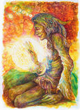 Green hippie indian shaman with a ball of healing white light. Stock Image