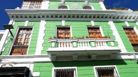 Historic colonial palace of Quito daytime. Green historic colonial palace of Quito daytime stock video