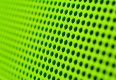 Green holes. Futuristic green hole grid making an abstract pattern Stock Photo