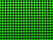 Green Holes. Futuristic green hole grid making an abstract pattern Royalty Free Stock Photo