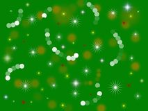 Green holiday background. Stars bulbs shine brightly on a green background Stock Image
