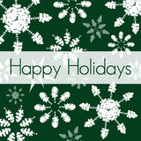Green Holiday Card. Holiday card with snowflakes made out of tree silhouettes, drawn in Illustrator Royalty Free Stock Photos