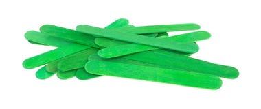 Green holiday craft sticks Stock Photos