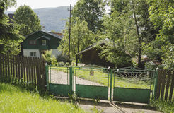 Green holiday house and fence in Sinaia mountain resort Royalty Free Stock Photo