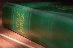 Green Holy Bible in sunlight. Religion and faith concept. Religious literature. Green Bible . Christianity background. Vintage Bible book in light. Church royalty free stock photography