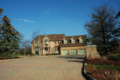 Green Home. Green luxury house with 3 door garage and large interlocking stone driveway stock photography