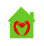 Green home icon with heart symbol isolated on white Stock Photo