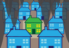 Green Home. One green energy efficient home, surrounded by cold and smokey uninsulated houses Stock Photo