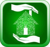 Green home in open hands Stock Photos