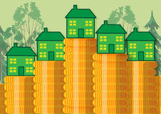 Green Home Savings. Green homes sitting on a stack of gold coins. This is a metaphor for energy cost savings Royalty Free Stock Images