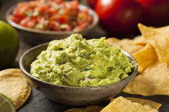 Green Homemade Guacamole with Tortilla Chips Stock Photos