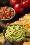 Green Homemade Guacamole with Tortilla Chips. And Salsa Royalty Free Stock Image